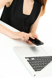 Woman browsing on her smart phone at the office Royalty Free Stock Photo