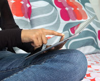 Woman browsing intenet on a tablet computer Royalty Free Stock Images