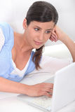 Woman browsing the Internet Royalty Free Stock Images