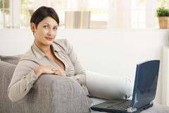 Woman browsing internet at home Stock Images