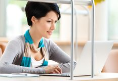 Woman browsing on the laptop Stock Photos