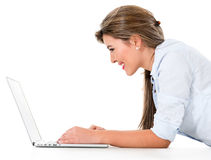 Woman browsing on a laptop Stock Image