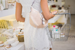 Woman browsing products Royalty Free Stock Photos