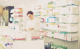 Woman is browsing rows of body care products Royalty Free Stock Photo