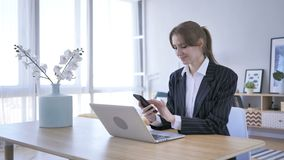 Woman Browsing on Smartphone at Work stock footage