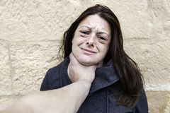 Woman with bruised eyes. In battered, domestic violence stock photo
