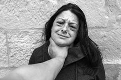 Woman with bruised eyes. In battered, domestic violence stock photography