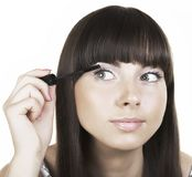 Woman brunette applying make up mirror reflection Royalty Free Stock Images