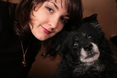 Woman brunette with dog Royalty Free Stock Photo