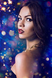 Woman brunette with fashion make-up. Christmas snow, snowflakes background. Stock Photography