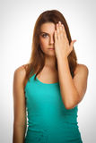 Woman brunette girl covered her face half a hand Stock Image
