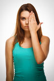 Woman brunette girl covered her face half hand Stock Image