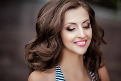 Woman brunette with make up and in a swimsuit. royalty free stock photo