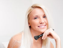 Woman with a brush Royalty Free Stock Photography