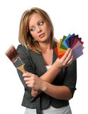 Woman With Brush and Color Swatches. Gorgeous woman with paint brush and color swatches over a white background Royalty Free Stock Image