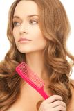Woman with brush. Health and beauty concept - beautiful woman with long hair and pink brush Royalty Free Stock Images