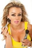 Woman brush makeup Royalty Free Stock Photography