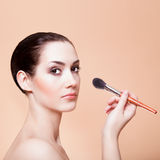 Woman with brush for makeup Royalty Free Stock Images