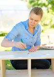 Woman with brush. Stock Image