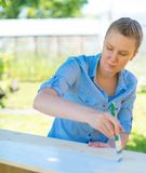 Woman with brush painting. Royalty Free Stock Photography