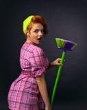 Woman with brush. Young beautiful woman with brush , studio shot stock photos