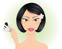 Woman with brushes. Royalty Free Stock Image