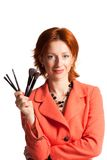 Woman with brushes for a make-up in hands Stock Photos