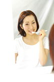 Woman brushes teeth Stock Photography