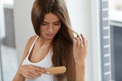 Woman Brushing Beautiful Healthy Long Hair With Brush Portrait Stock Photos