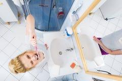 Woman brushing cleaning teeth in bathroom Stock Image