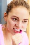 Woman brushing cleaning teeth in bathroom. Woman brushing cleaning teeth. Girl with toothbrush in bathroom. Oral hygiene royalty free stock photos