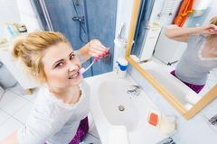 Woman brushing cleaning teeth in bathroom Royalty Free Stock Images