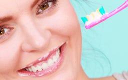 Woman brushing cleaning teeth Stock Image