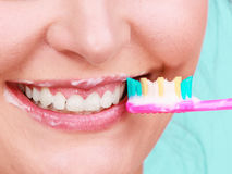 Woman brushing cleaning teeth Stock Images