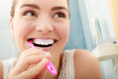 Woman brushing cleaning teeth. Oral hygiene. Young woman brushing cleaning teeth. Girl with toothbrush in bathroom. Oral hygiene Royalty Free Stock Photography