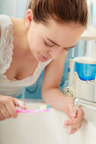 Woman brushing cleaning teeth. Oral hygiene. Stock Photography