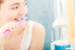 Woman brushing cleaning teeth. Oral hygiene. Young woman brushing cleaning teeth. Girl with toothbrush in bathroom. Oral hygiene Royalty Free Stock Photo