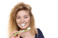 Woman brushing cleaning teeth royalty free stock images