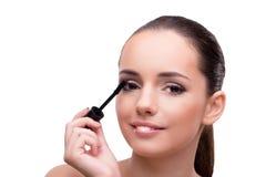The woman brushing eyelashes isolated on white Royalty Free Stock Photo