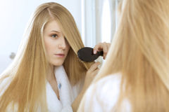 Woman brushing hair Royalty Free Stock Images