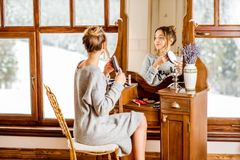 Woman sitting at the dressing table during the winter Royalty Free Stock Photos