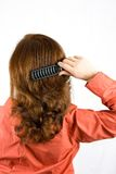 Woman brushing her hair. Isolated on white Stock Photos