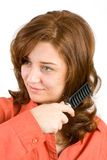 Woman brushing her hair Royalty Free Stock Photos