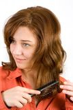 Woman brushing her hair Stock Image