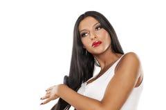 Woman brushing her hair Stock Photos