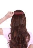 Woman brushing her hair Royalty Free Stock Image