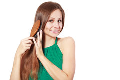 Woman brushing her hair Stock Images