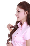 Woman brushing her hair on white background Royalty Free Stock Image