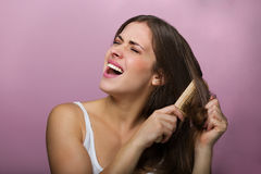 Woman brushing her hair Royalty Free Stock Photo
