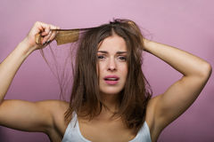 Woman brushing her hair Stock Photo